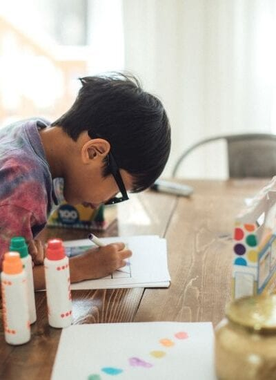 A child working on a math project using paints and markers is a great example of how there doesn't have to be an unschooling vs homeschooling dynamic.