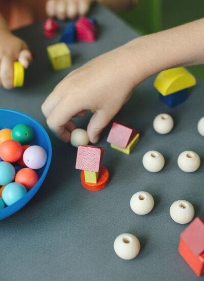 Children playing with blocks and beads as in the picture above are a great example of how homeschooling can be more fun and interactive for your children than you might expect.